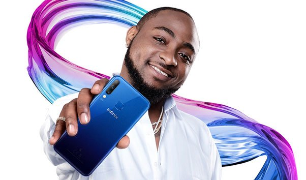 Davido holding latest Infinix phone