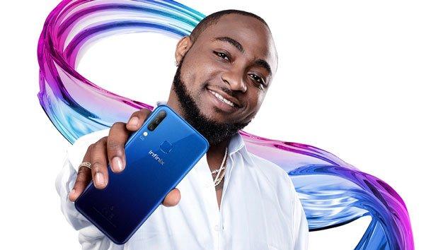 Davido holding latest Infinix phone